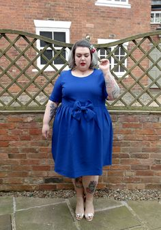 The perfect plus size wedding guest dress by Manon Baptiste at Navabi. Simple yet cute and eye catching, this cobalt blue dress with its big bow detail is a dream come true!