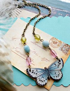 flutterby. Butterfly necklace, pale blue, wood, paper, illustration, mariposa, insect, entymology, recycled beads, biology, gift for her by FabFleaMarket on Etsy