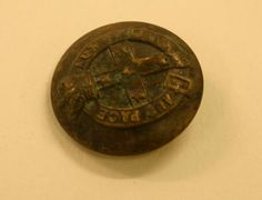 ButtonShop.ca  - This military brass button with motto AUT PACE AUT BELLO (either in peace or in war) was excavated at the Commonwealth Block site between 1988 and 2003. Buttons such as this were used by the Victorian Volunteers in the nineteenth century between 1880 - 1892, when the motto was changed to PRO DEO ET PATRIA, VICTORIA (for God and country). Brass buttons were worn by regular soldiers within the force