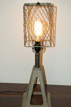 Upcycled, aluminum jack stand table lamp. $70.00, via Etsy.