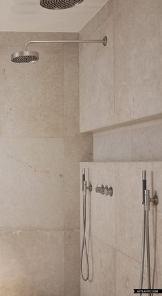 Soft and warm natural limestone inside the bathroom of the Harmonious House by Dennis T. Jampens.
