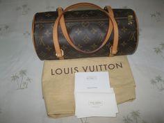 A classic Louis Vuitton  bag designed by Henri Vuitton in 1966 -- unique because of its barrel shape