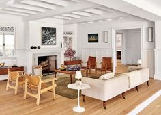 an open living room with warm neutrals and white walls | pilar guzman house tour via coco kelley