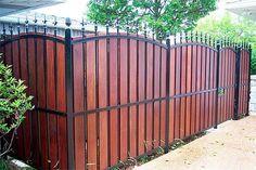 wood and black iron fence