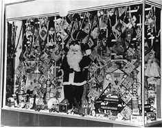 Santa Claus in a Christmas store window.