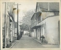 """""""AVILES STREET - one of the many old narrow streets of the picturesque city of St Augustine"""", quoted from the reverse.  An image by the Keystone View Co. Inc. of N.Y., dated May 15, 1930."""