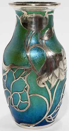 """Lot:071002: ART NOUVEAU SILVER OVERLAY GLASS VASE, H 5 3/4"""", Lot Number:71002, Starting Bid:$350, (Sold for $850.) Auctioneer:DuMouchelles, Auction:071002: ART NOUVEAU SILVER OVERLAY GLASS VASE, H 5 3/4"""", Date:06:00 AM PT - Jul 9th, 2011"""