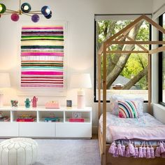 Girl's bedroom with a bed shaped like a house, colorful art that has pops of pink, and a rainbow chandelier by Sazerac Stitches Baby Boy Nursery Decor, Baby Boy Nurseries, Chandelier, Rainbow Decorations, Colorful Interiors, Girls Bedroom, Decorative Items, Modern, Kids Room
