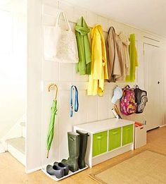 Two rows of hooks & a storage bench = an organized entry way.