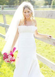 #RealBride wearing a pleated bodice wedding dress designed by heidi elnora!