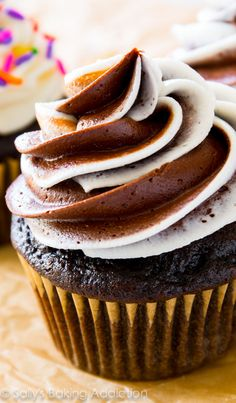 The one and only homemade chocolate cupcake recipe you need! Topped with fluffy, rich vanilla chocolate swirl frosting. @sallybakeblog