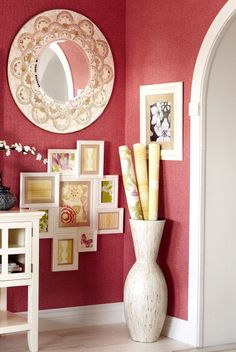Try displaying various prints and art in photo frames