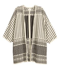 Natural white/black. Jacquard-knit cardigan with 3/4-length sleeves, slits at sides, and no buttons.