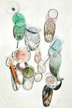 a collection of colorful glassware