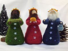 Three Kings - Needle Felted for Epiphany celebrations.    A unique and wonderful set of three majestic Kings from the orient bearing gifts of gold, frankincense and myrrh for the new baby Jesus.    These 3 figures are each carefully needle felted from hand dyed fibres. They stand approx 13cm (5) tall and are about 6cm (2.25) across their base. Their arms have wire pipecleaners inside and their gifts for the baby Jesus are attached using invisible thread. I have decorated them with tiny…