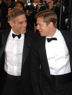 George Clooney and Brad Pitt dressed in tuxedos at a film festival