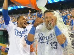 Alcides Escobar dumps Gatorade on Salvador Perez after his hit a walk-off single in the 12th inning.