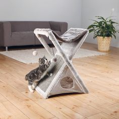 """Give your cats a fun and comfortable place to play, lounge, or sleep with this 25"""" Cat Tree. It is great for eclectic and modern home decors.It features a cozy plush fabric and a durable sisal scratching surface. It is available in multiple finishes for you to choose from. This sleek cat condo has a single-tiered design. It is non-toxic, making it safe for use. This wonderful cat condo is scratch resistant, making it a welcome addition to your home. It is a great combination of symmetry ..."""