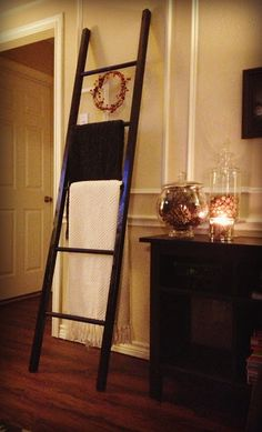 "$10 Quilt Ladder - DIY  1"" dowel rods (cut rods into 3 equal pieces), 2 x 2 outside legs--space dowel rods 14"" apart, screw screws into dowel rods from the outside."