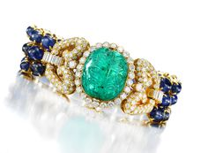 Van Cleef & Arpels. A Sapphire Bead Bracelet with a Carved, 'Egyptian Revival' Cabochon Emerald and Diamond Baguettes, circa 1975.   Available at FD. www.fd-inspired.com