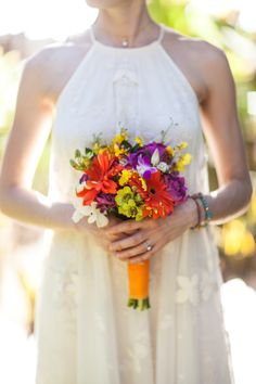 #Bouquet | a simple Pop of color works great for this #beach wedding | Photography: A Brit & A Blonde | See more on SMP - http://www.StyleMePretty.com/destination-weddings/2014/01/09/costa-rica-destination-wedding/