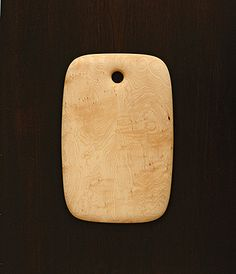 I think this is a cutting board but it would make a nice simple necklace.