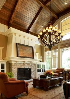 Very high ceiling with beams. Stone gas fireplace. Outlets in the middle of the floor to avoid lamp cords from going across the room. Windows that face the back yard.