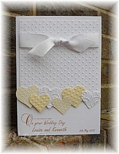 Lovely idea: mixing up various hearts (or other die cuts), each embossed with a different design. Lots of possibilities!