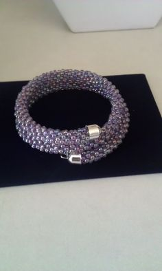 Purple seed bead Kumihimo bracelet Strung on memory wire ... good idea! Why do endcaps have loops??