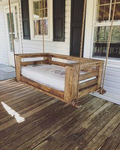 A handmade porch swing sized to the standard crib mattress (54x31). This swing is assembled with all screws and glue to ensure a durable, long-lasting swing. All holes are filled with wood filler to ensure that not a single screw can be seen. The swing is sanded several times in different grit to ensure a smooth safe surface (80, 120, and 220). The swing is stained/painted in a color of your choice and then sealed to protect the swings finish from the elements. I do recommend adding an a... Bed Swings, Backyard Swings, Porch Swings, Backyard Patio Designs, Backyard Ideas, Front Porch Curtains, Porch Swing Pallet, Decks And Porches, Crib Mattress