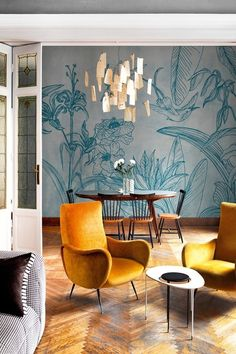 Yellow velvet vintage chairs against blue foliage Wall and Deco by SOTTOBOSCO