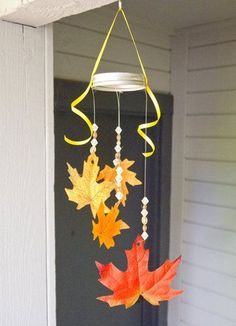 Fall Leaf Mobile: Perfect for lil ones, this simple Fall leaf mobile uses silk leaves and sparkling beads to create a welcoming outdoor decoration.  Source: So Says Sarah . . .