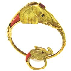 View this item and discover similar for sale at - A Charming gold and coral bracelet and ring. The yellow gold hinged bracelet in the shape of the head of a mother elephant with sapphire eyes, and Elephant Jewelry, Elephant Bracelet, Animal Jewelry, Coral Bracelet, Coral Jewelry, Peacock Jewelry, Antique Bracelets, Jewelry Bracelets, Statement Bracelets