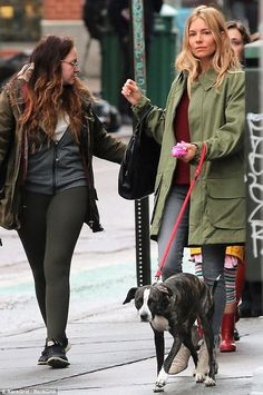 Rainy day:Sienna Miller was spotted walking her dog with five-year-old-daughter Marlowe a...