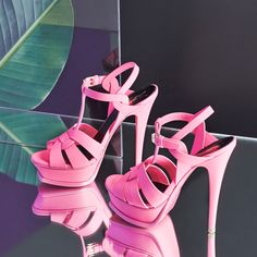 Step out of the ordinary in neon pink strappy summer sandals.