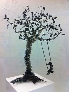 Black tree swing wire sculpture