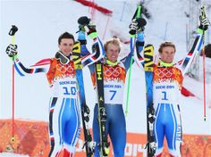 Silver medalist Steve Missillier of France, gold medalist Ted Ligety of the United States, and bronze medalist Alexis Pinturault of France celebrate during the flower ceremony for the Alpine Skiing Men's Giant Slalom. Sochi 2014 Day 13 - Alpine Skiing Men's Giant Slalom.