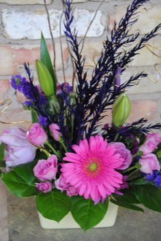 purple flowers, pink gerber daisy, small spring floral arrangement