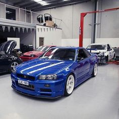 Nissan skyline r34 gtr, blue and white rims, perfect