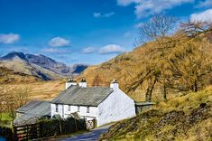 a typical Lake District region home with whitewashed stone walls