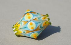 Handmade lampwork glass focal bead in bright colors by FlameJewels, $35.00