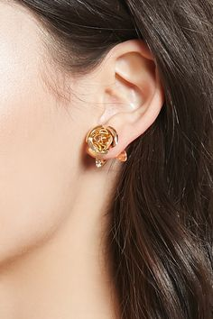 A pair of high-polish stud earrings featuring a rose design, removable leaf details and post-back closures.