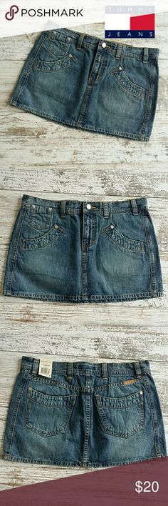 "Tommy jeans denim mini skirt size 7 *cute light wash jean skirt  *100 % cotton   *5 pockets  *15.75 "" across the waist   *12.25 "" waist to hem   * sorry, no trades Tommy Hilfiger Skirts Mini"
