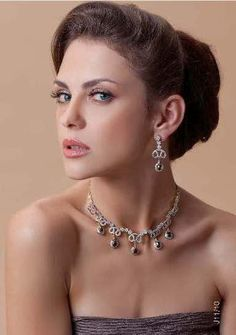 Necklace and earrings in gold and silver finish with cubic zircon and black stones, priced at $149.
