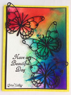 "By Patsy Collins. Tap Color Bursts onto watercolor paper; spritz with water. Dry. Add mats and card base. Stamp sentiment. Add black die-cut ""Vivienne"" butterflies (Memory Box)."