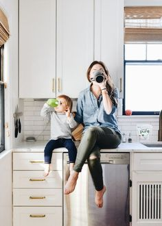 Mother And Son Discover 10 Time-Saving Mom Hacks That Will Streamline Your Life - Francois et Moi % % Mother drinking coffee daughter drinking hot chocolate from a sippy cup. Both sitting on kitchen counters by Erin Francois Mommy And Son, Mom Daughter, Mom And Baby, Mother Daughters, Lifestyle Photography, Children Photography, Indoor Family Photography, Glamour Photography, Editorial Photography