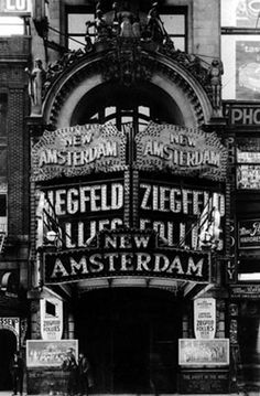 """42nd Street in the 1920s with the New Amsterdam advertising """"The Ed Wynn Carnival"""" and the marquee with the Ziegfeld Follies."""