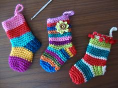 These Mini Christmas Crochet Stockings are an easy FREE Pattern that is ideal for beginners. Check out the Crochet Stockings Advent Calendar Ornaments as well! Mini Christmas Stockings, Crochet Christmas Ornaments, Christmas Crochet Patterns, Holiday Crochet, Christmas Presents, Diy Christmas, Stocking Ornaments, Mini Stockings, Christmas Knitting