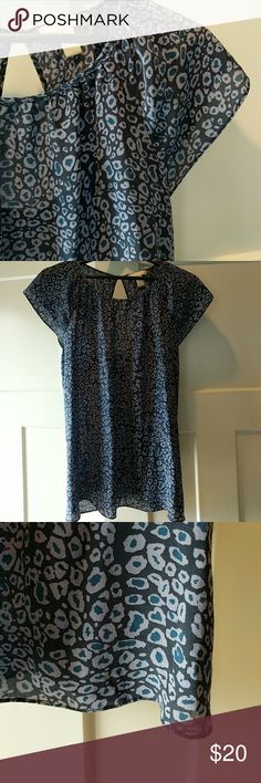 """Banana Republic 100% silk cut out back top 14 Excellent condition!  Teal and steel grey pattern.  Dry clean only.  Elegant cut out back features your upper back.  25"""" top to bottom; 19"""" arm pit to arm pit. Banana Republic Tops Blouses"""