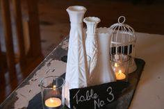 Slate base. Table no. 3 on slate. 3 milk glass vases. 3 votive candles. Mini bird cage. https://www.facebook.com/focalpointdesignsanddecor